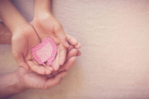 A hand holding a baby Description automatically generated